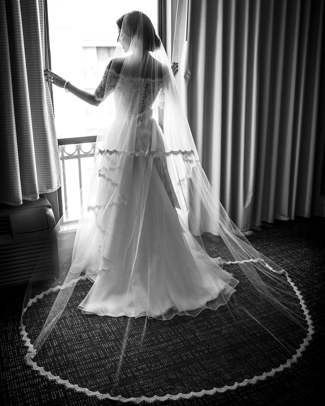 Classic elegance. The dress reflects on the window coverings creating a glow around the bride. #Marriage #Wedding #WeddingDay #GettingReady #Bride #Dress #WeddingDress #elegantdress #Elegant #Classic #LuxuryWedding #WeddingPlanner #LAWeddingPlanner #Orang