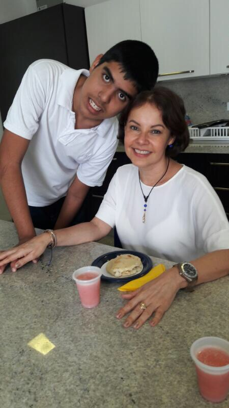 Elida Marroquin, (LLFH representative) tasting an arepa, a typical Venezuelan food made by David Luzardo, a Fupanaz student.