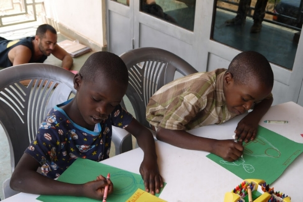Manzi and myself in the background, drawing pictures for sponsors.