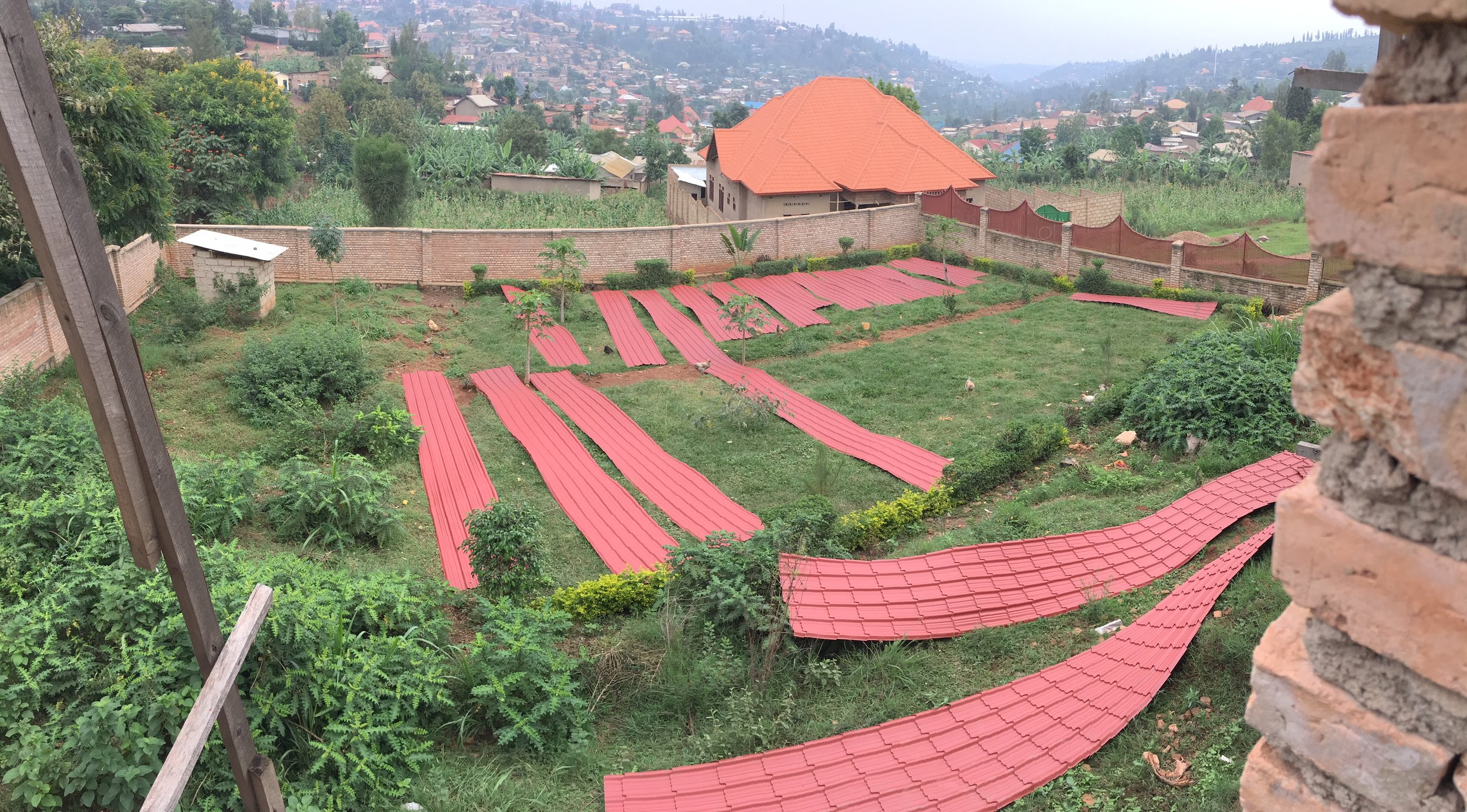 Spreading out the metal roofing sheets on the lawn