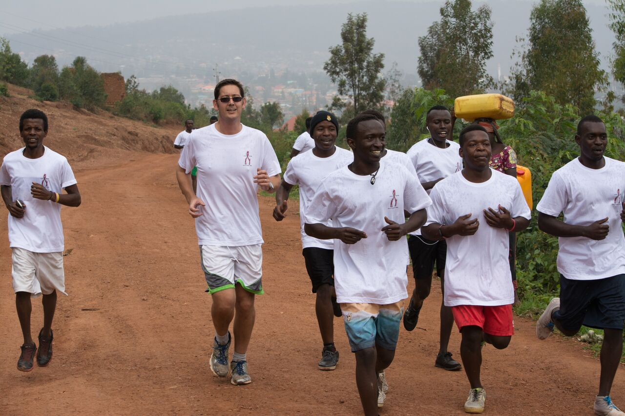 Some of our kids and Doug ( A volunteer) running