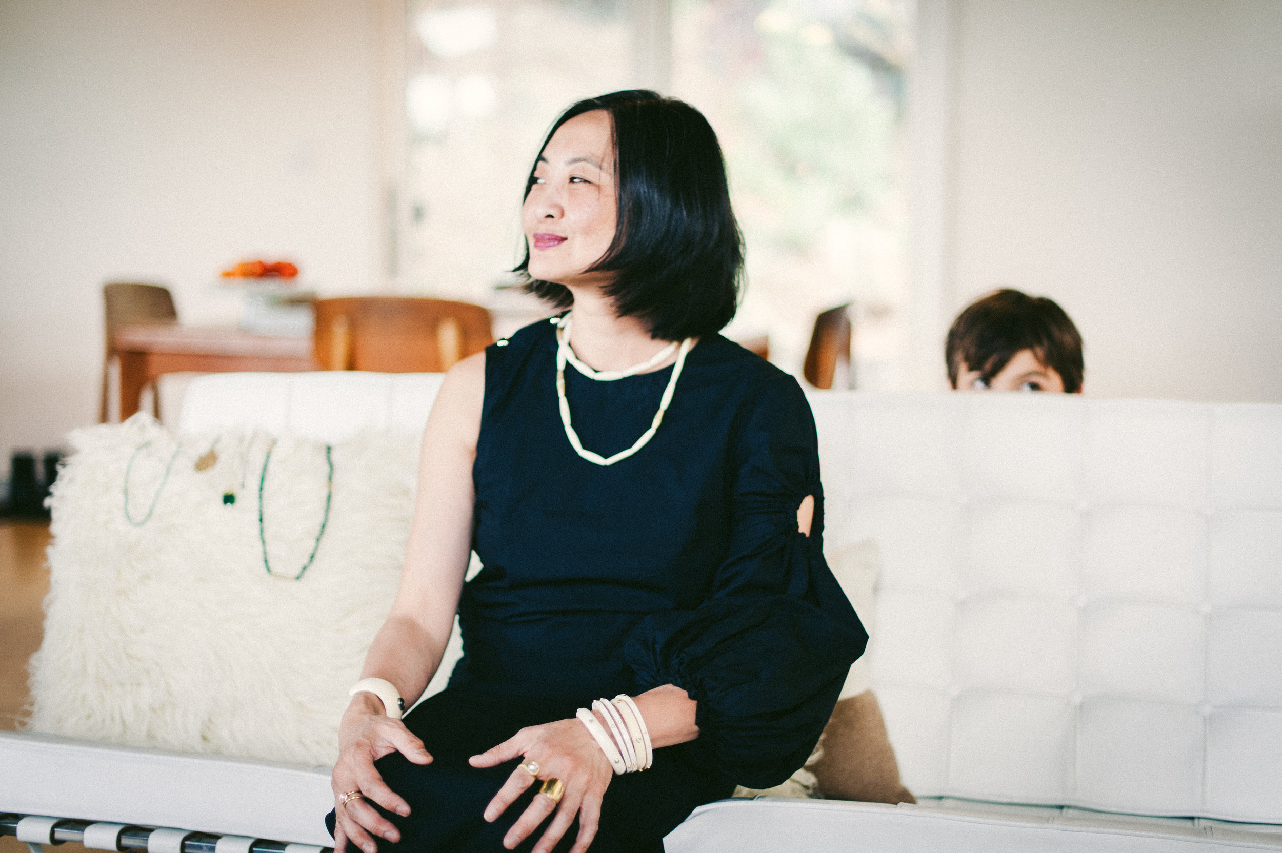 Jill and her son in their home. Jewelry collection by April Higashi.