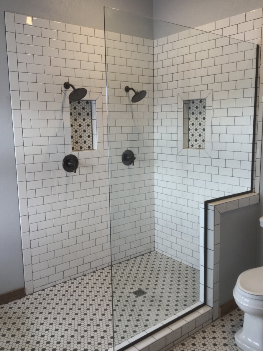 New walk-in shower with white tile.png