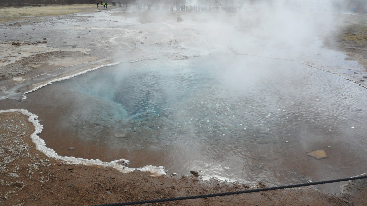 In spite of signs in multiple languages warning people not to throw trash in the geothermal pools, there is a lot of change in most of the geothermal pools at Geysir.