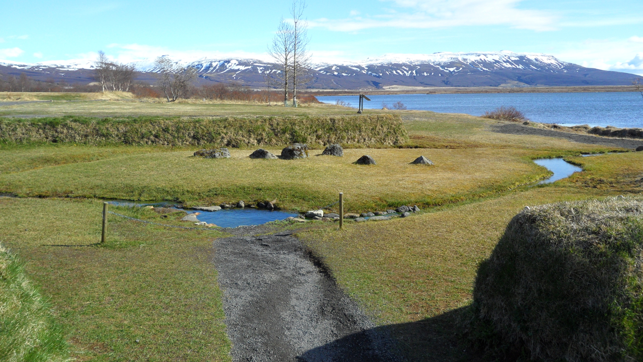 "This consecrated pool at Laugarvatn is flanked by stones known as ""body stones,"" and it plays a part in one of Iceland's sagas."