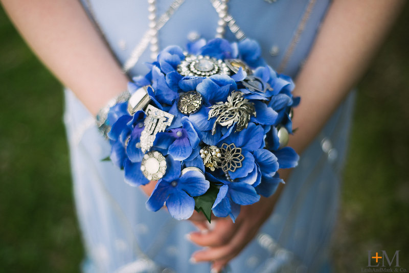 Tracy made the bouquets, using costume jewelry (her own and her grandmother's), vintage-look buttons, and a pearl necklace given to her by her other grandmother.