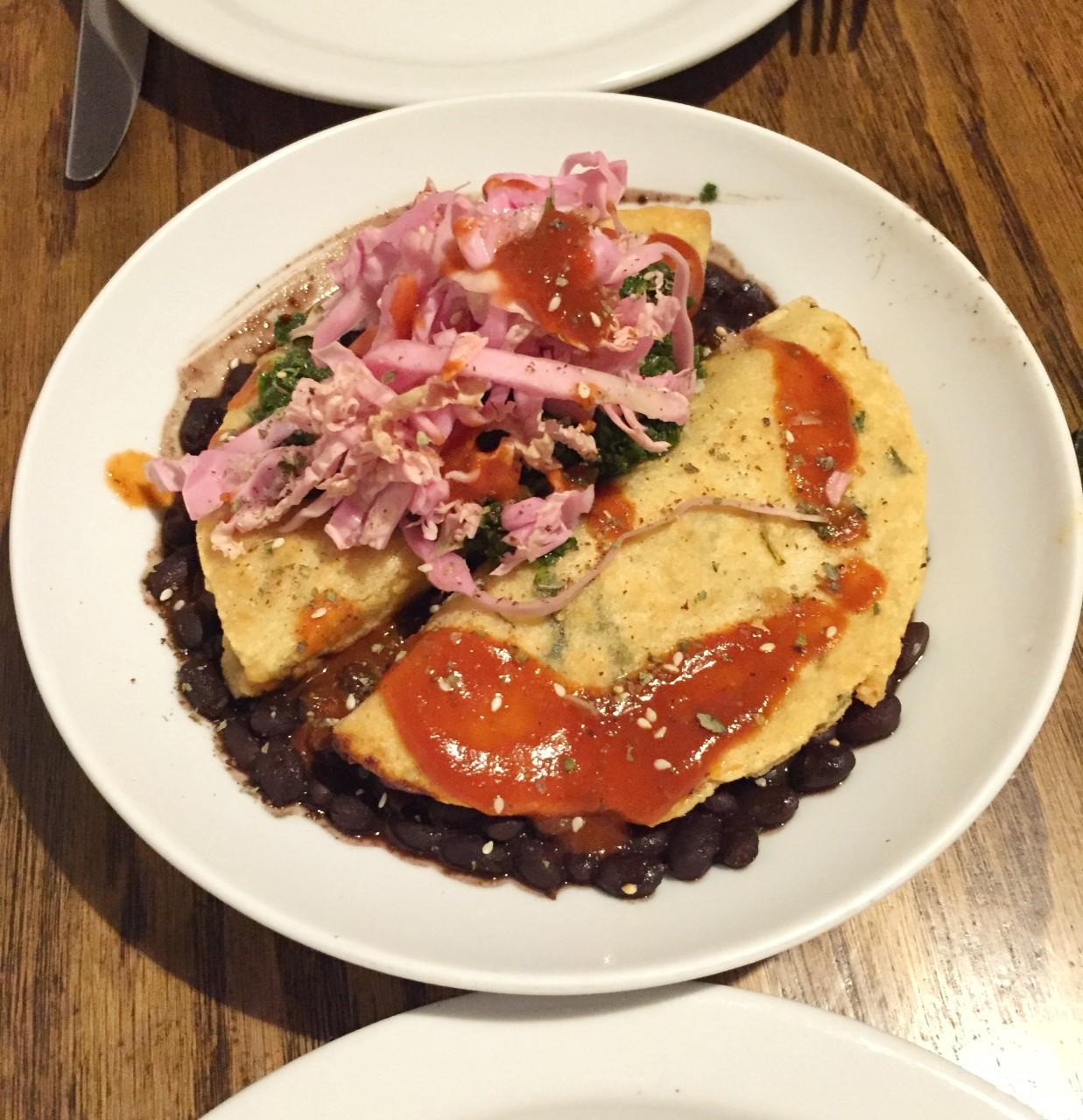 Picadillo Empanadas over cacao black beans