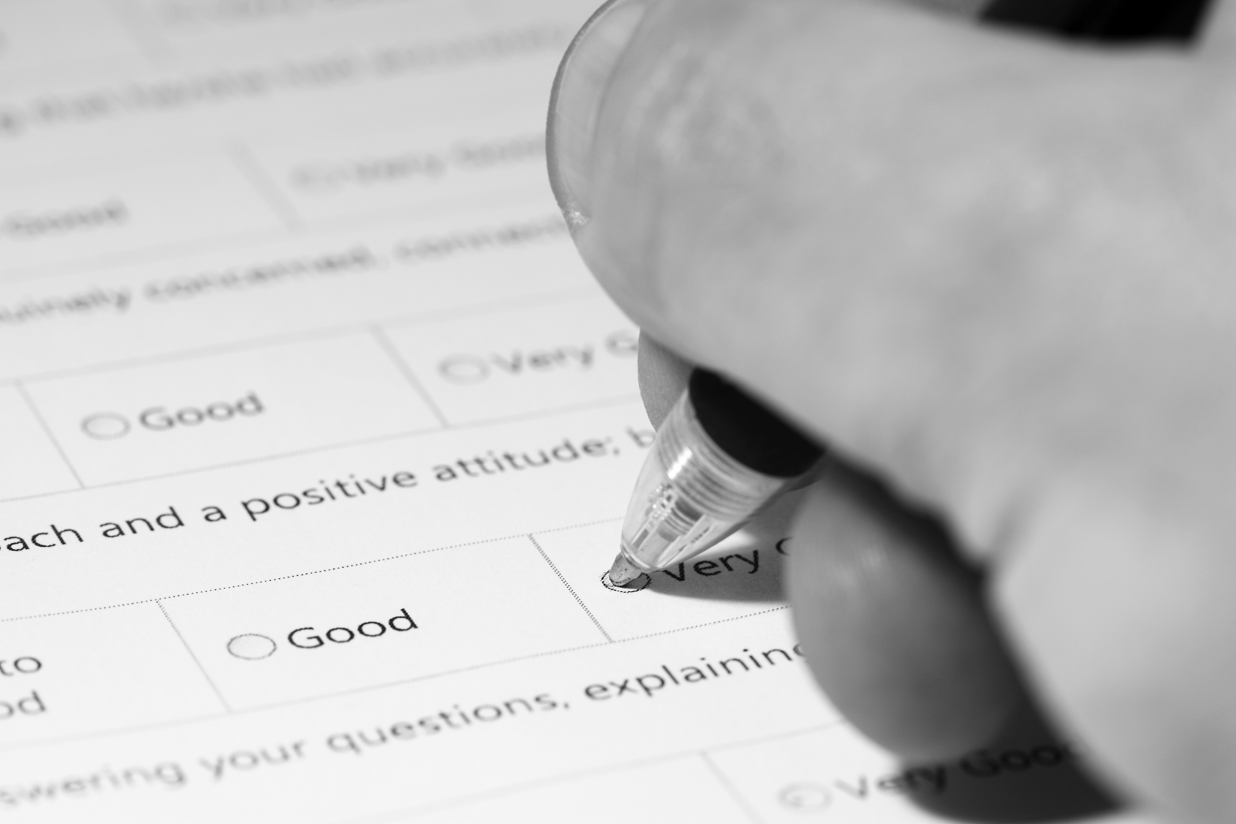 Filling in questionnaire. Man filling in a medical questionnaire.