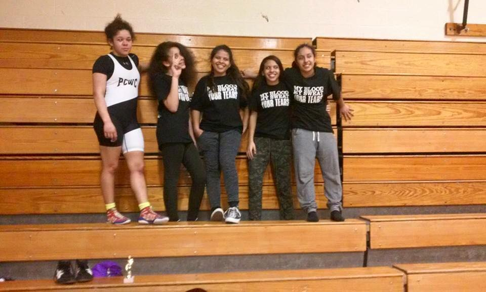 Lakeisha (far left) with her teammates and students.