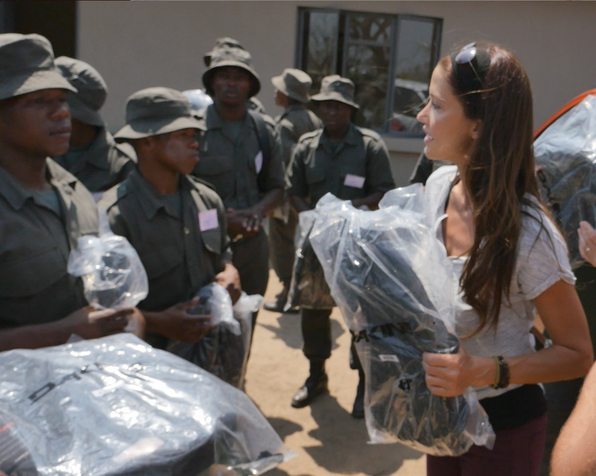 Delivering backpacks to students at the South African wildlife College.