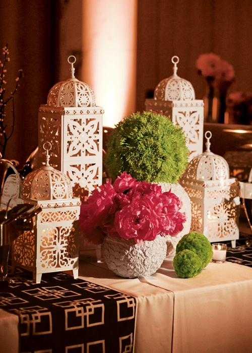 Candle-lit lanterns and bold flowers