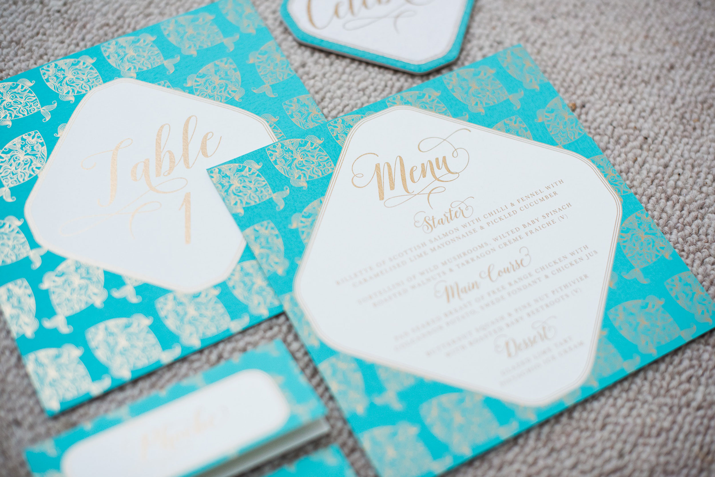 trio-of-life-fish-blue-menu-table-number-wedding-invitation.jpg
