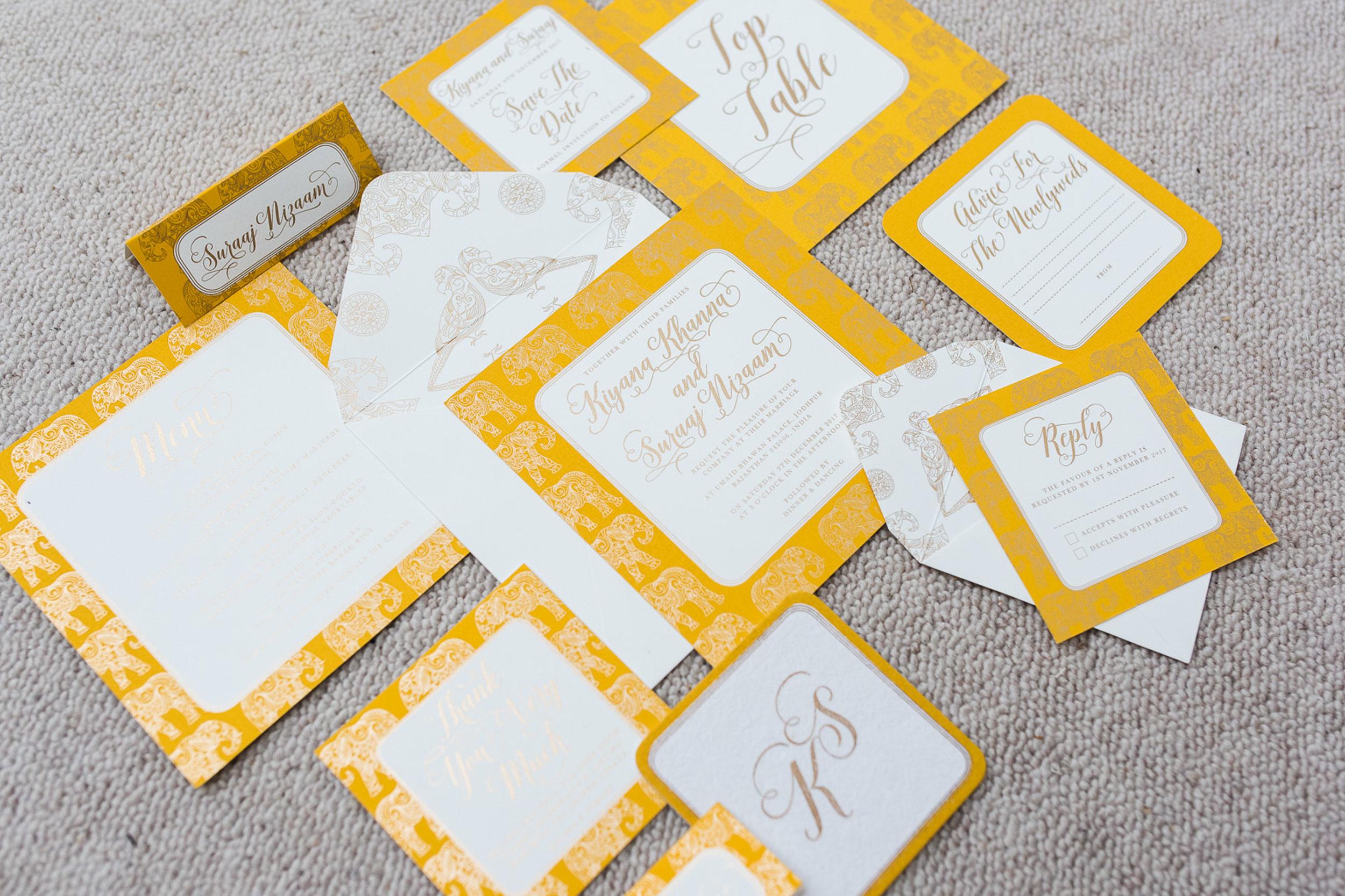 trio-of-life-gold-elephant-wedding-invitation.jpg