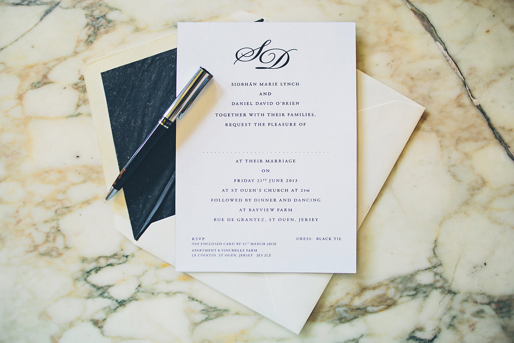 Engraved monogram wedding invitation