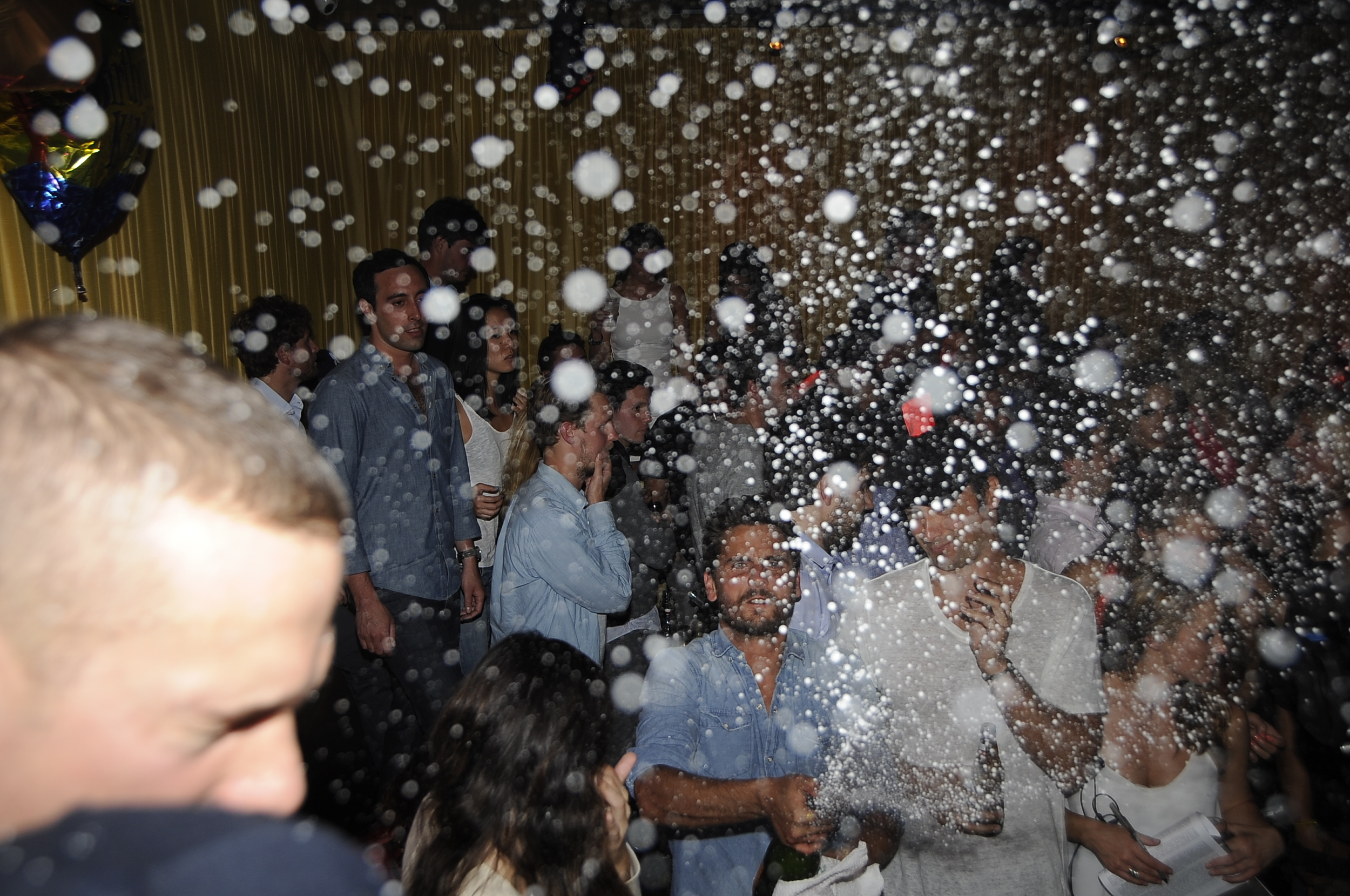 Scott Disick acts out spraying Champagne at 10oak in South Hampton.