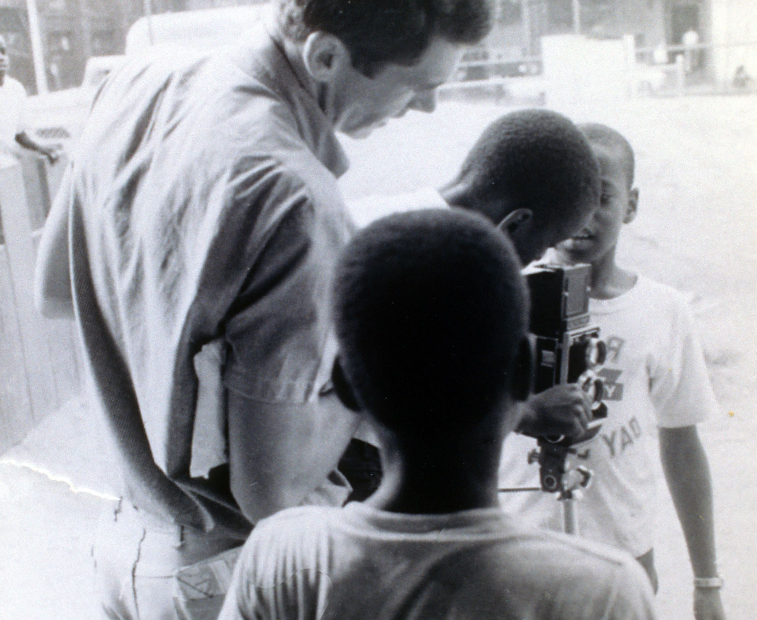 Mike working on one of several photo essays commissioned by J. Walter Thompson Advertising. Harlem, New York..jpg