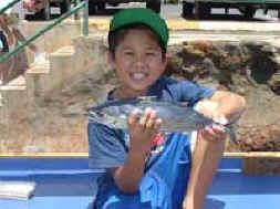 Kid's fishing off Maui, Hawaii