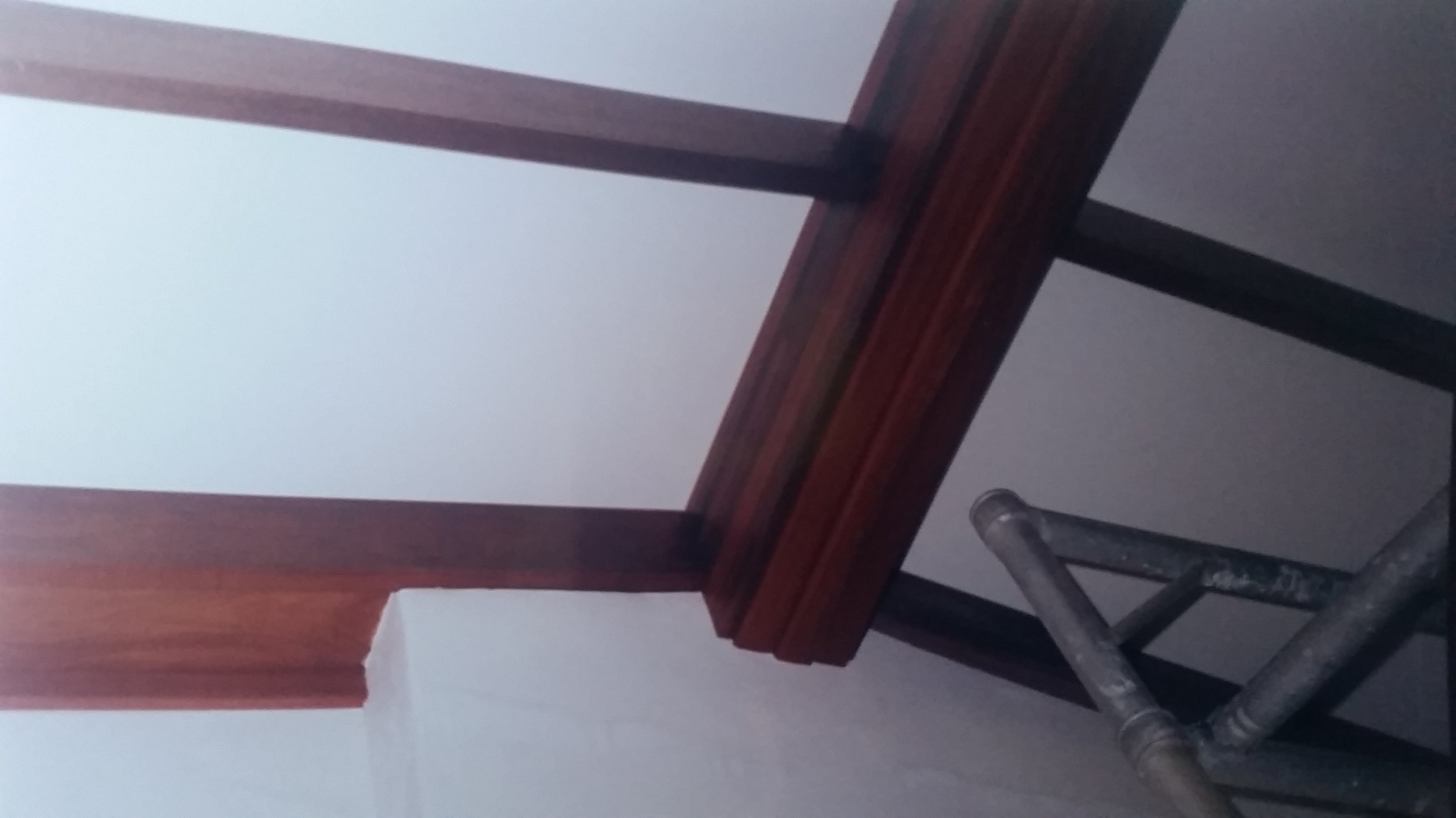 Brickwork completed, plasterwork done, exposed jarrah beams lacquered.
