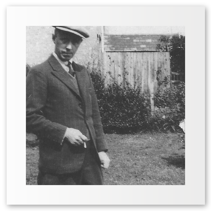 Great Granddad (James Richard) Robinson, formally relaxing in peak lapels. Somewhere in the mid 20th century: in a garden, somewhere. 1st Generation.