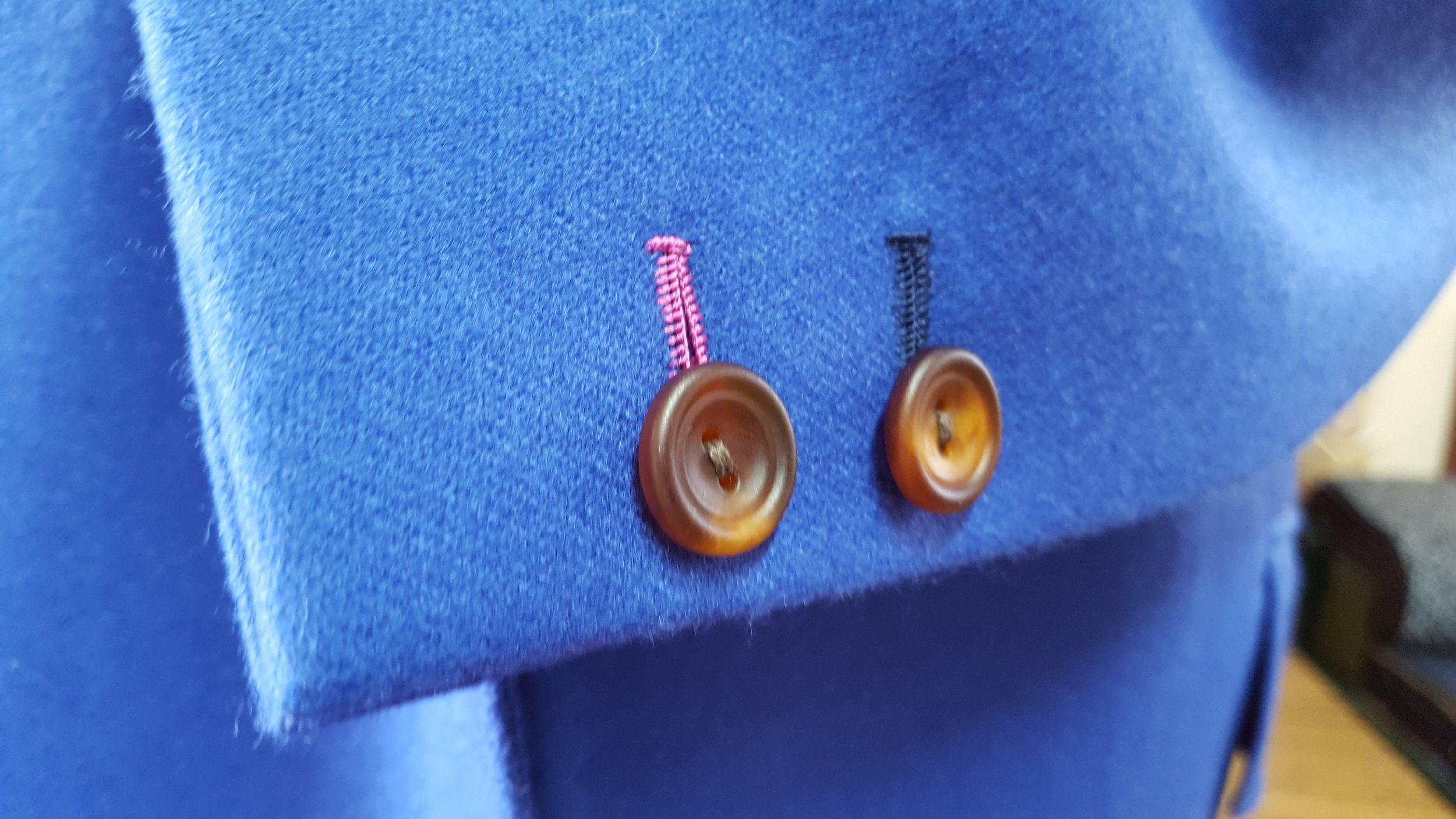 We decided to go with a handmade buttonhole (with contrasting thread to match the lining). Factory made jackets will usually have a machine made button hole but a handmade buttonhole is something that little bit special.