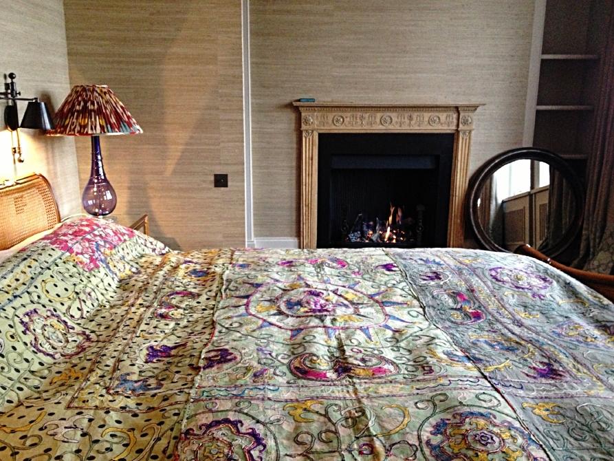 22.  Antique Uzbek textile found and made into a bedcover