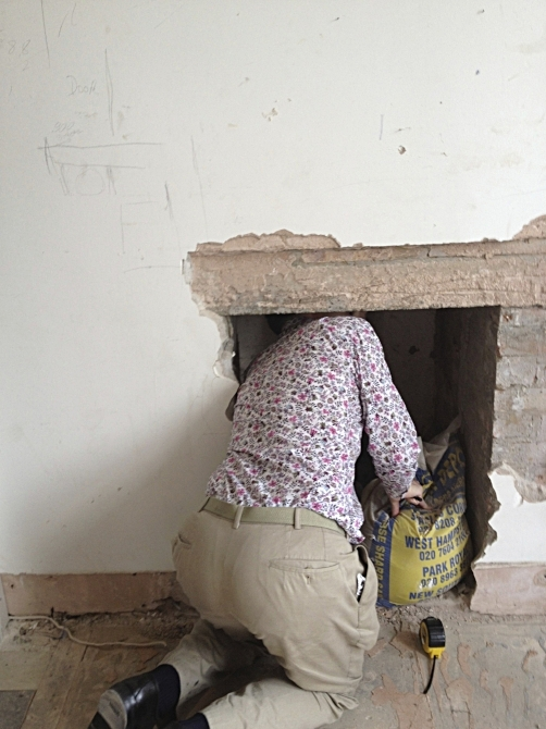 7. Inspect an air vent to see if we can install a fireplace, and we can.
