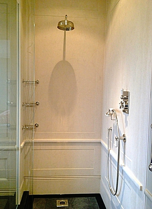 20. Limestone installed for showers with panelling detail to replicate joinery