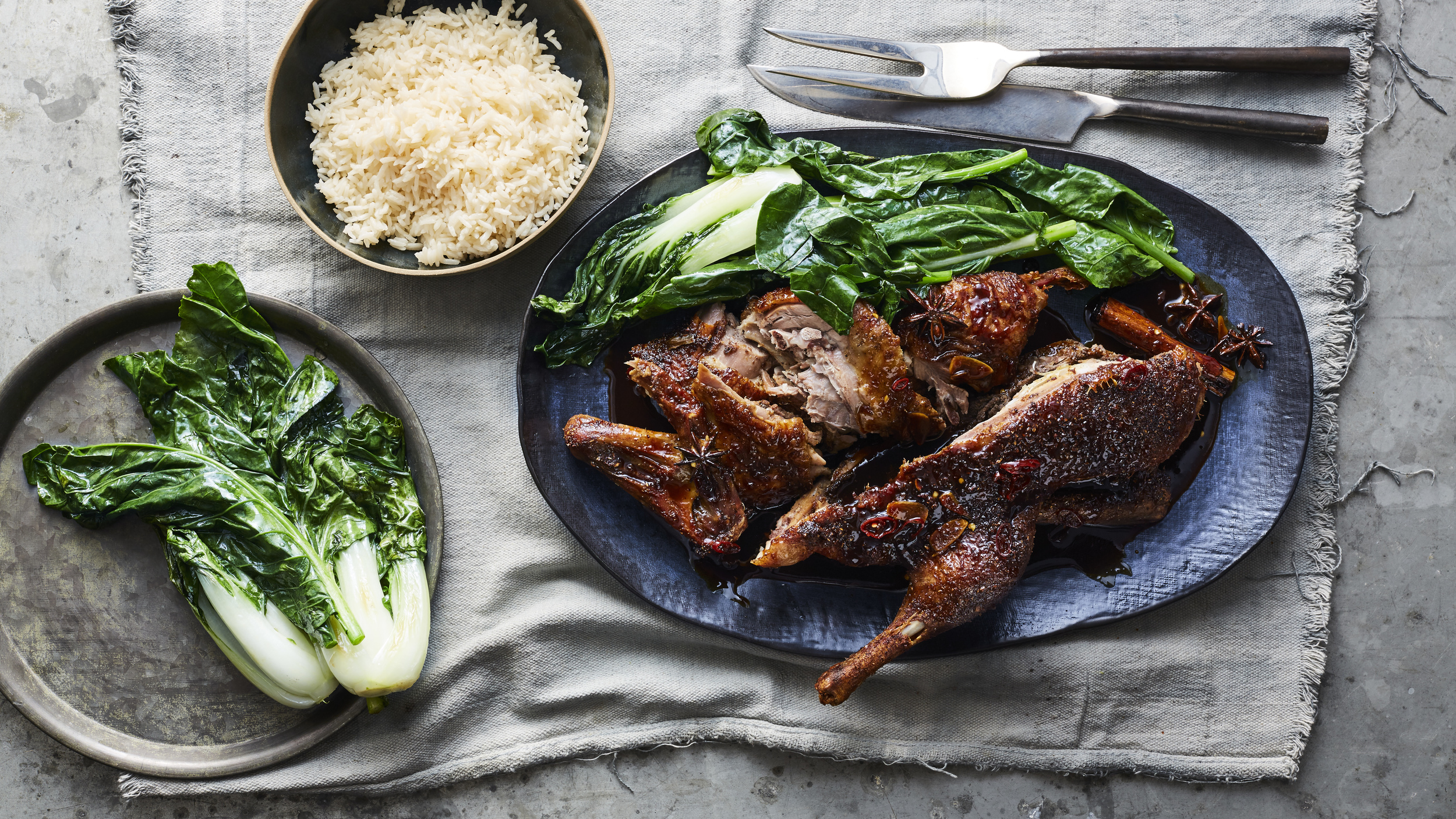 Spiced-honey roasted duck with rice and asian greens,Photography: Brett Stevens, Art Direction: Anne Marie Cummins, Food & Props Styling: Marcus Hay for SMH, Inc