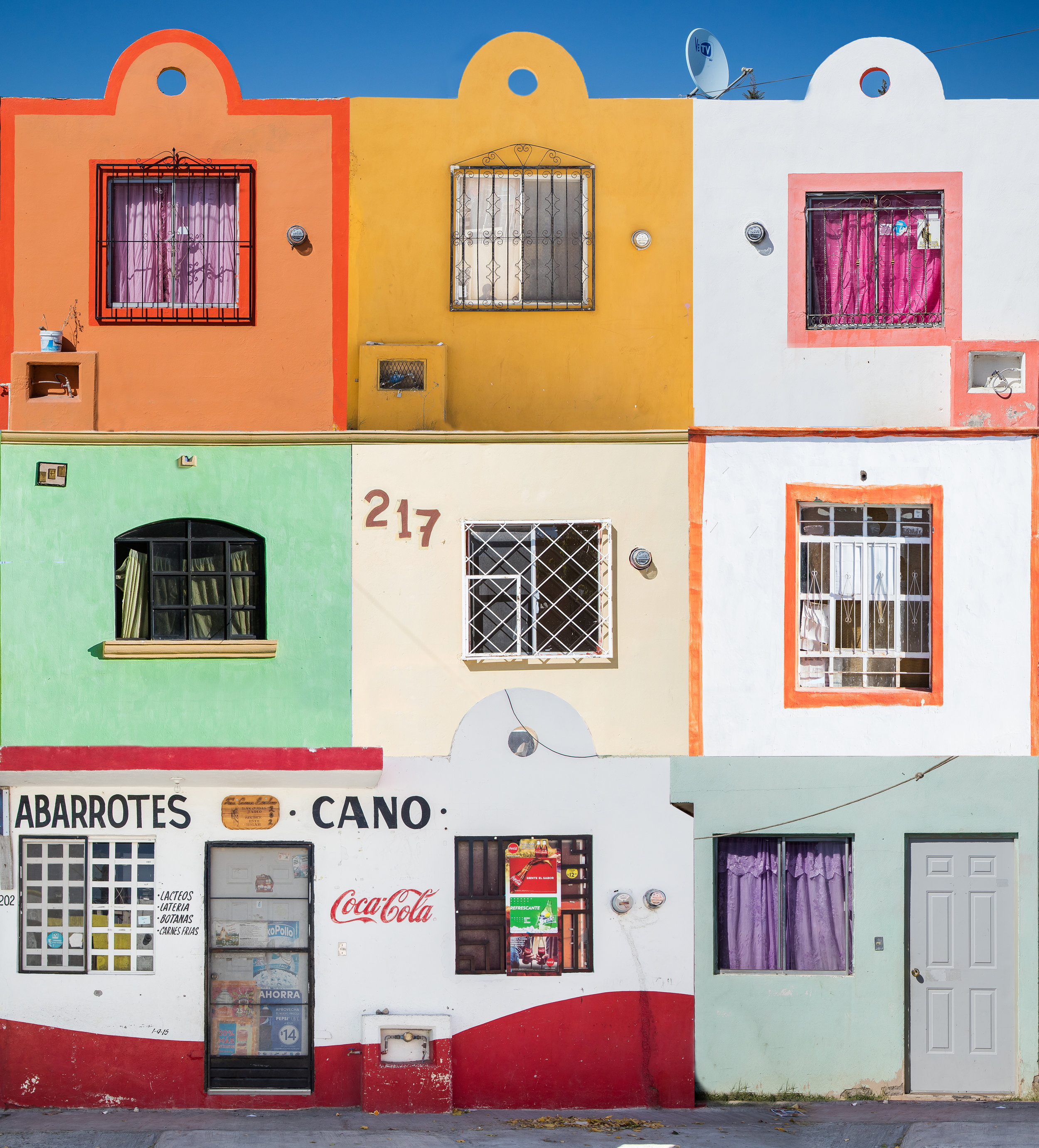 A collage of my favorite tiny stucco homes and shops seen in Parras de la Fuente, Mexico. This is 9 images stitched together with Photoshop in an attempt to resemble one cohesive structure.