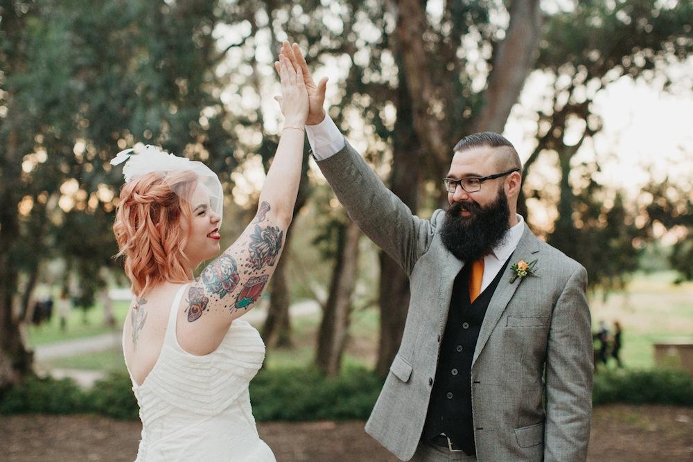 Tattooed Bride & A bearded groom high five, Art & Soul Events