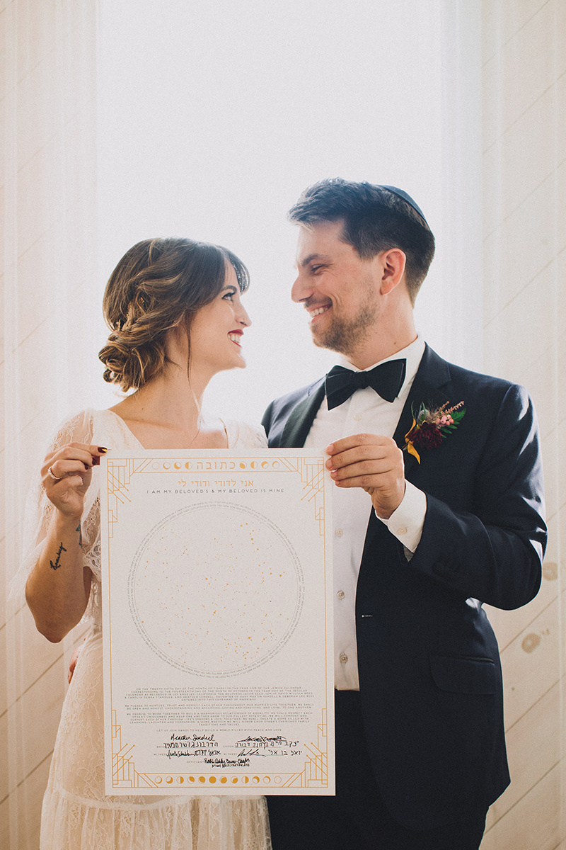 Ketubah signing,  Jewish Wedding Ceremony at Ruby Street, in Los Angeles, California. Photographer:  Mandee Johnson