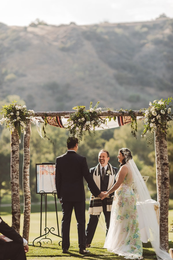 Ketubah  displayed under the chuppah at Mountaingate Country Club, Photographer:  Steve Cowell