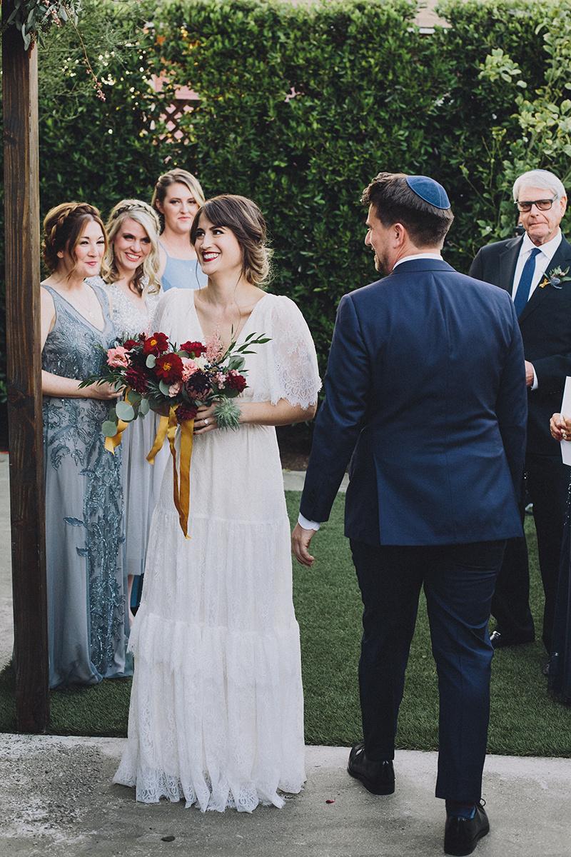 Hakafot,  groom circling bride at Ruby Street, Photographer:  Mandee Johnson , Florals: Hello Honey Flower Co.