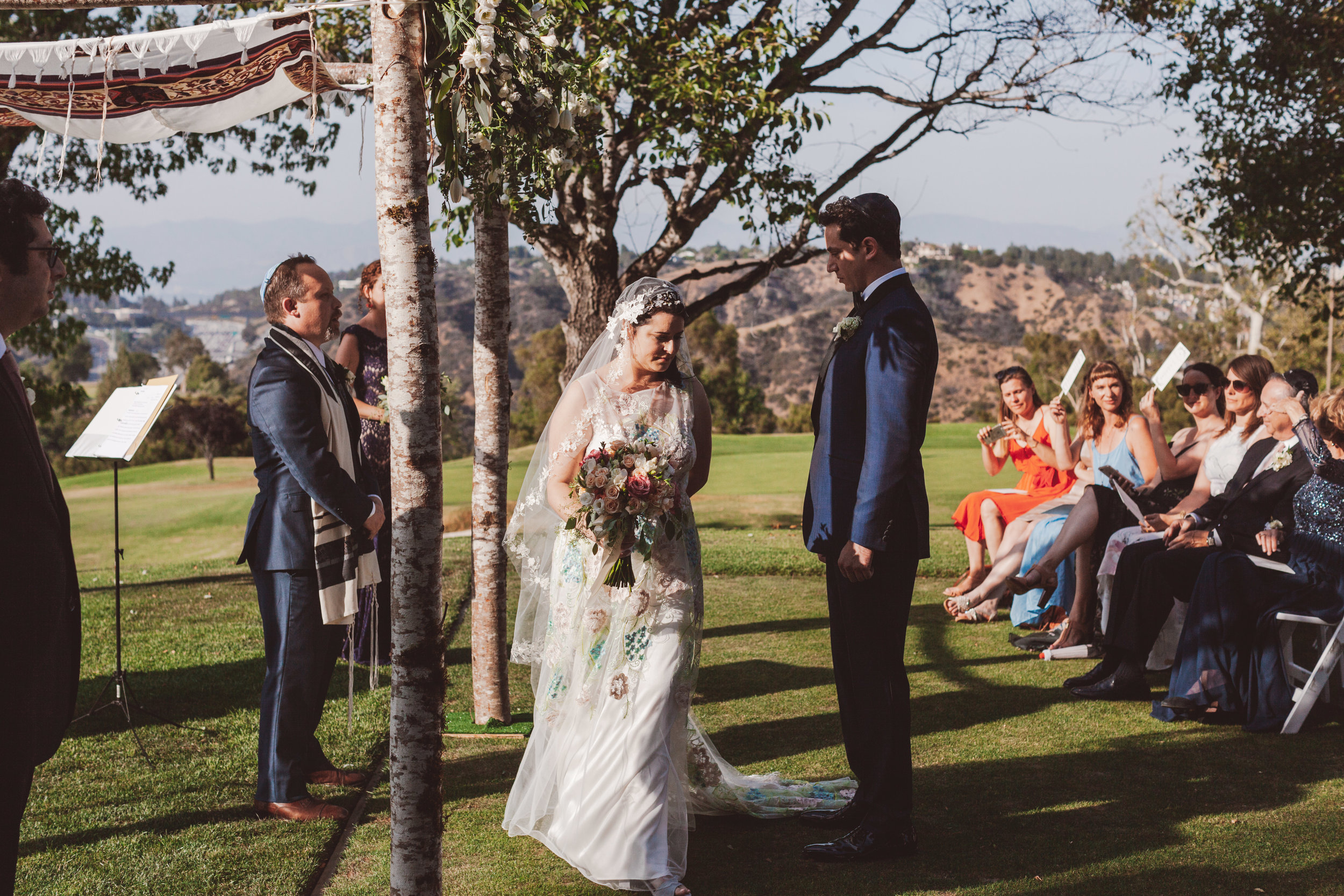 Hakafot , bride circling the groom at MountainGate Country Club, Los Angeles, CA. Photographer:  Steve Cowell,  Florals: Sonny Alexander