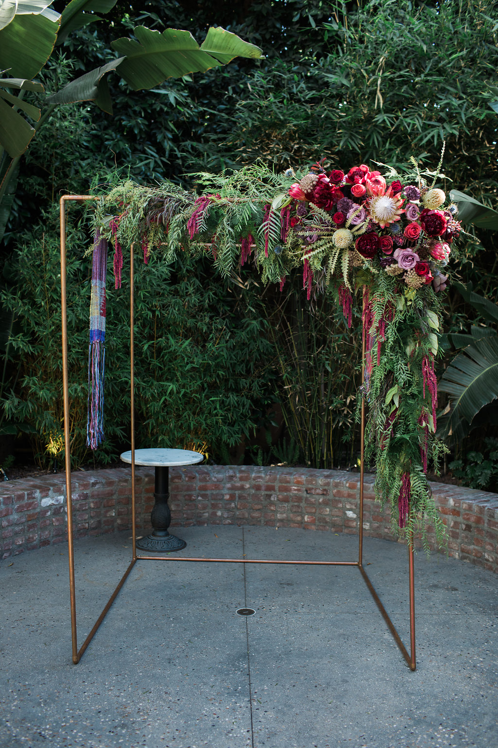 Bold and Industrial Colorful Chuppah  at Millwick, Photographer:  Casey Brodley , Floral Design:  Shindig Chic