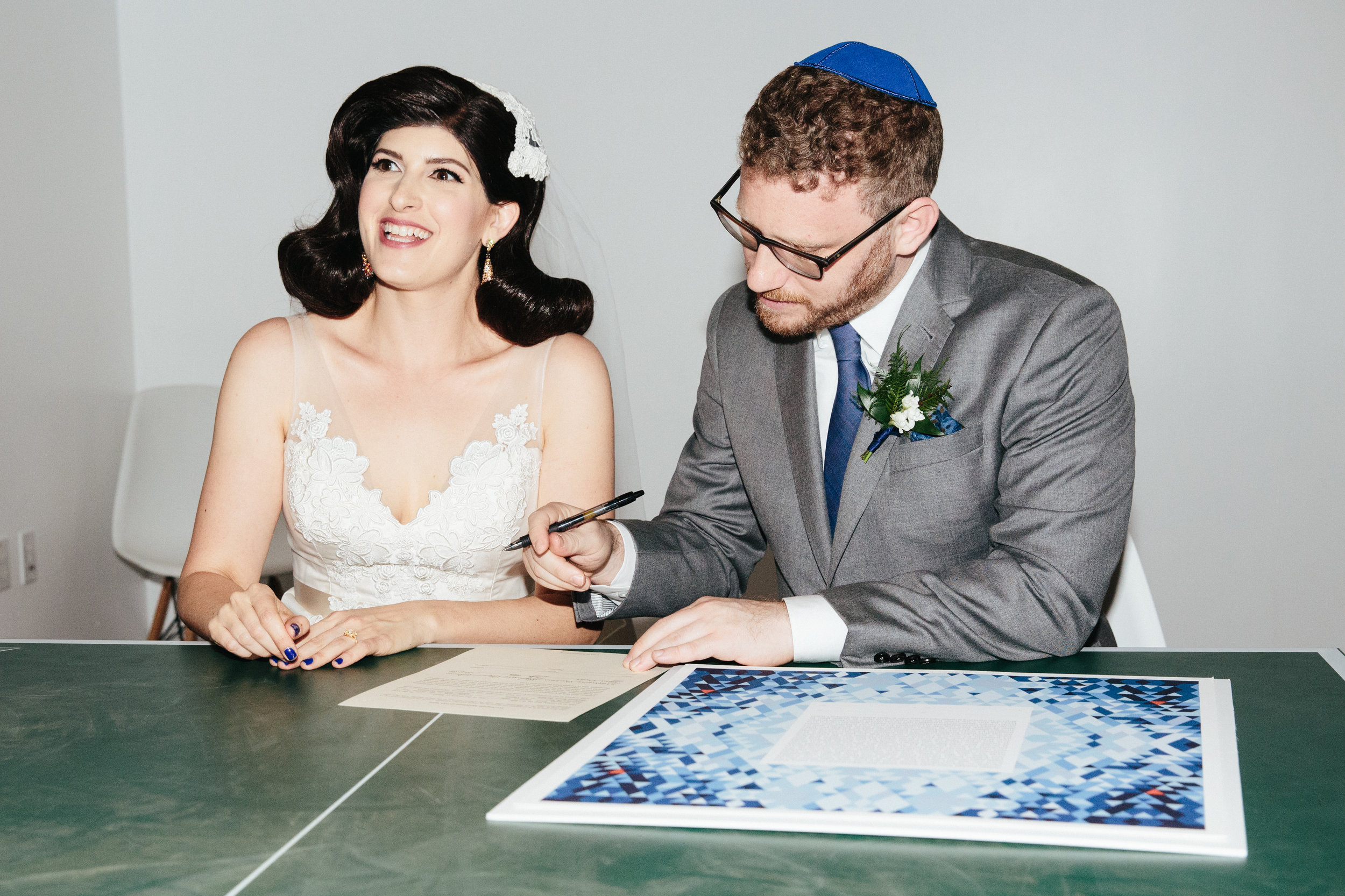 Ketubah Signing  at LA River Studios, Los Angeles, CA on a ping pong table. Photographer:  Our Labor of Love