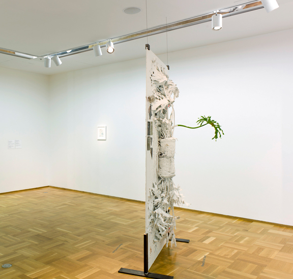 Pressed Plant (Hanging Gardens), 2012, Banana palm, latex paint, spray paint, glass, resin, mirror, glass, bone, porcelain, 92 x 45 inches