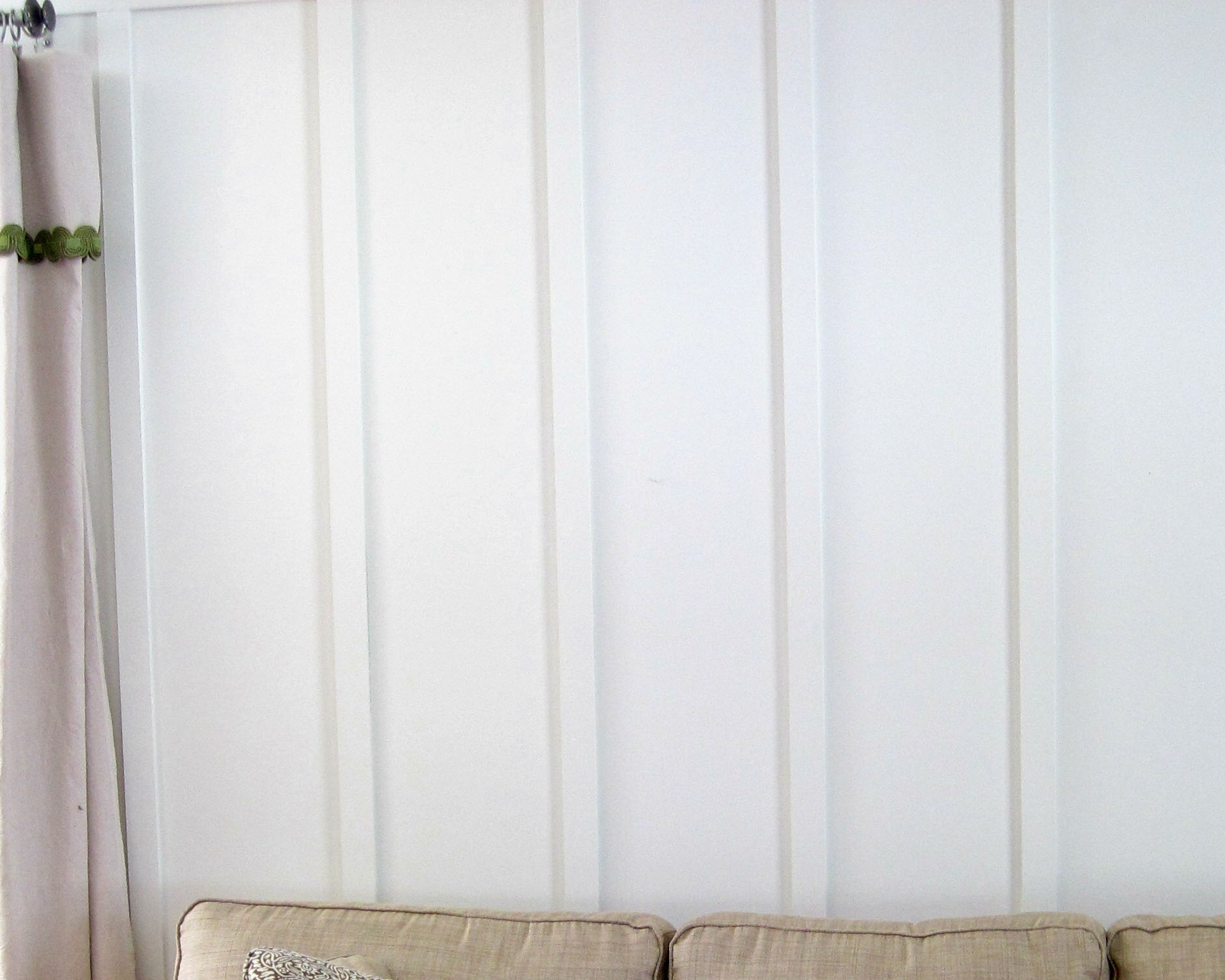 INCORRECT - Furniture and window is not visible, no paper on wall