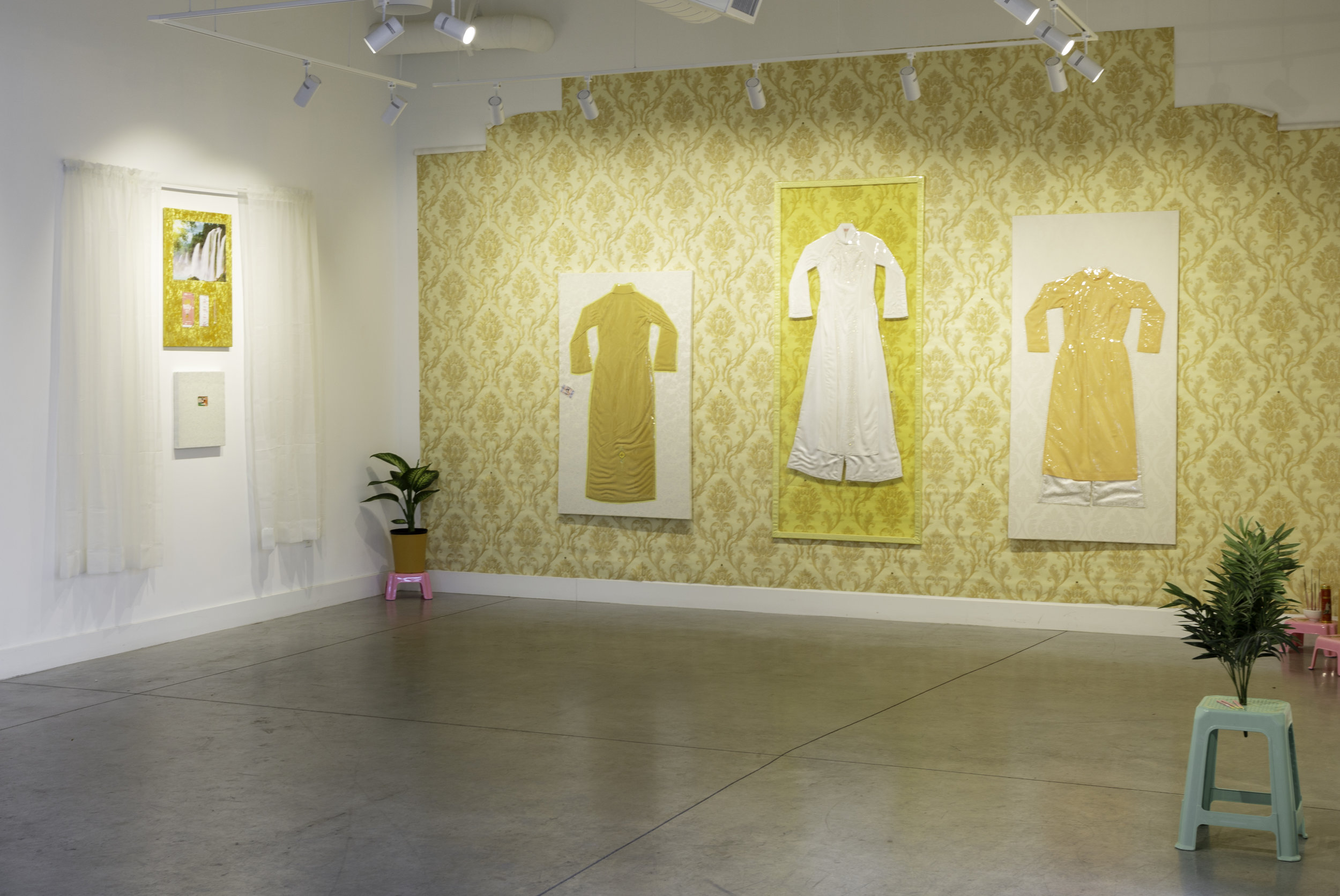 """""""Miss Vietnam"""" abstracts and analyzes mixed-race experience via symbols of Vietnamese femininity, yellow damask wallpaper (à la Charlotte Perkins Stetson's 1892 short story """"The Yellow Wallpaper""""), and mass-produced imported confections. The exhibition blends imagery of unnamed tropical jungles and Victorian interiors to create a disjointed memoryscape where a longing for cultural connection is endlessly sought but never reconciled.  photo Sara Ford"""