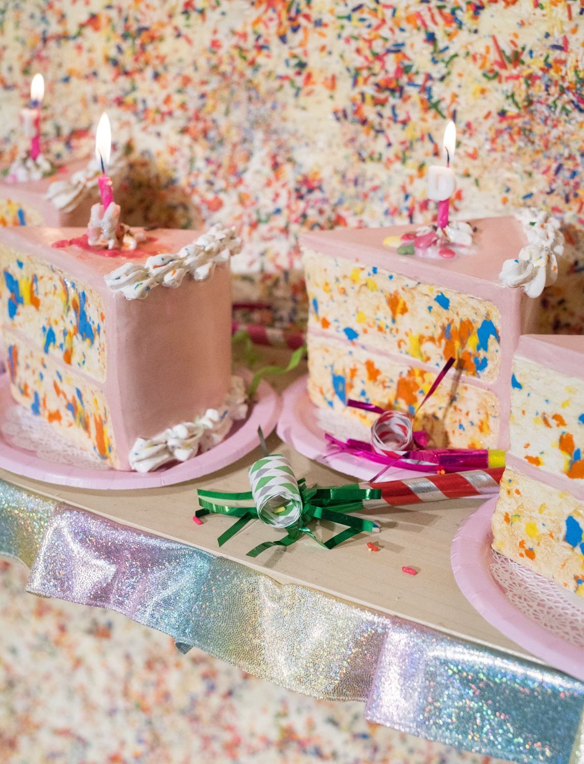 "Combining equal parts sculpture, installation, and performance,  Birthday Girl  accumulates the signifiers of American birthday tradition to excess. Centered around confetti cake and ""girl's birthday"" motifs, viewers are cordially invited to join in the festivities of a classic girl's birthday celebration.  Birthday Girl  assigns everyday of the exhibition as the artist's birthday, heralding the cake as a symbol of togetherness and celebration while challenging ubiquitous cultural expectation. (Birthday song optional)    photo Matt Pevear"