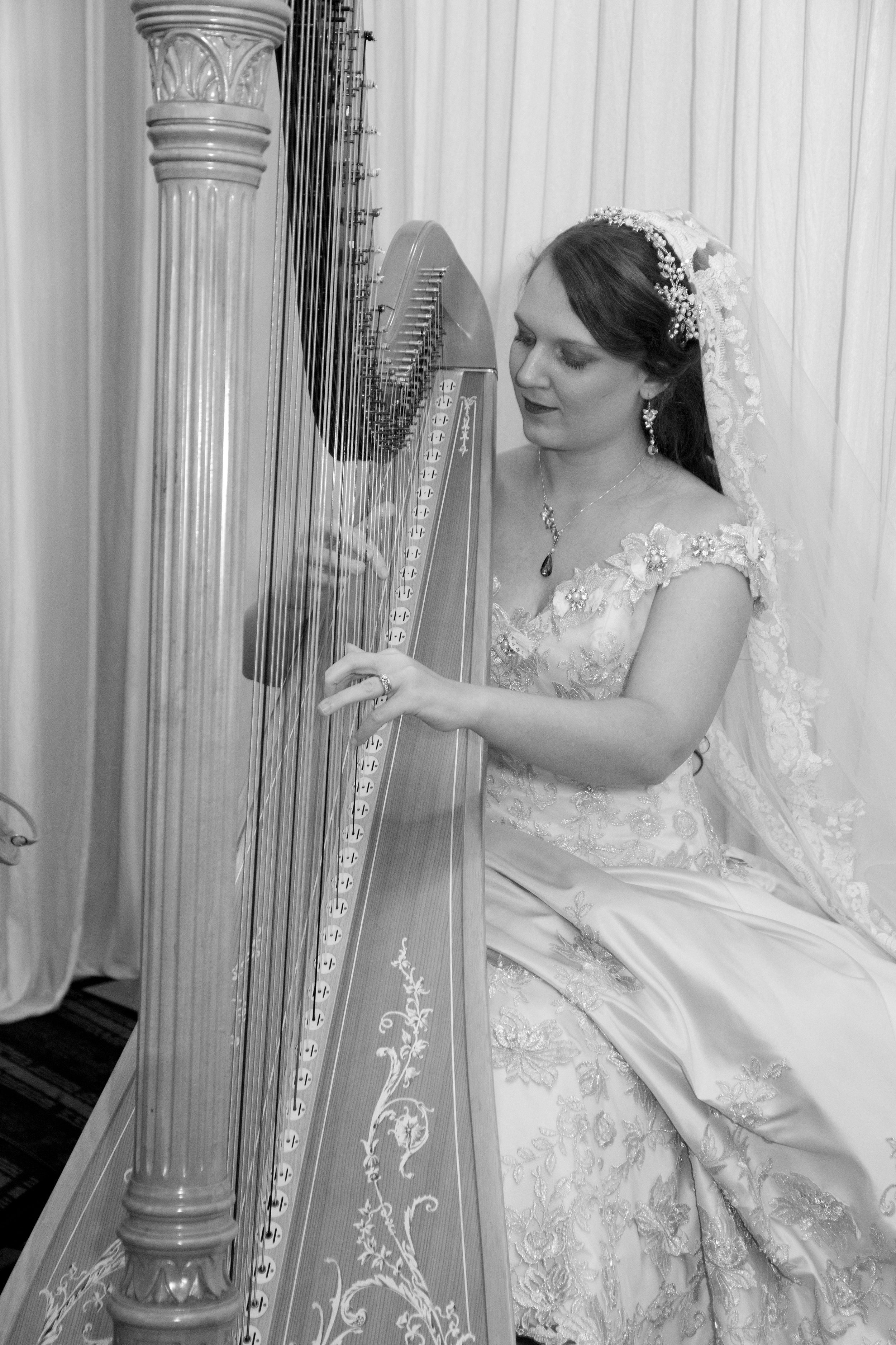 (Oh, and here's a photo from the wedding! Christa Grix was kind enough to play for our ceremony, and afterwards, she let me try her electro-acoustically modified harp! The photographer went wild!).