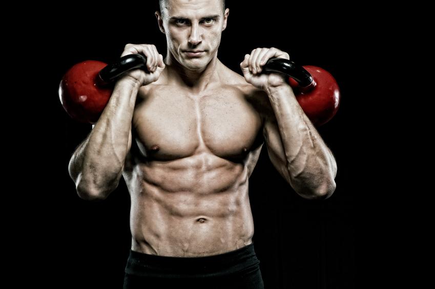 Muscular Man Holding Kettlebells.jpg