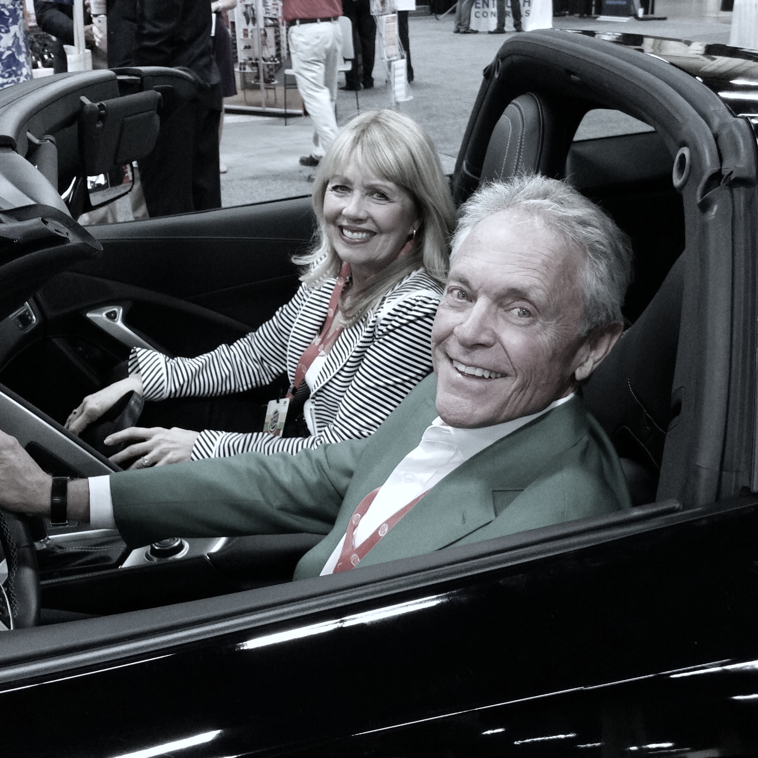 Tom Barnett in the Corvette he won and then sold in order to give his employees $120,000 in bonuses.