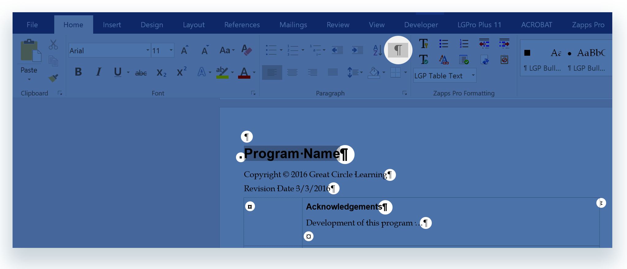Example of non-printing characters and the Paragraph Mark control button on Word's Home tab ribbon.
