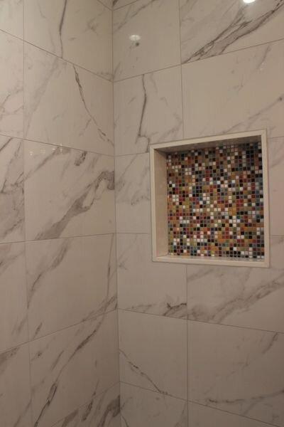Bryant_renovations_bathroom_renovation_funky_tiled_recessed_shower_shelf.jpeg