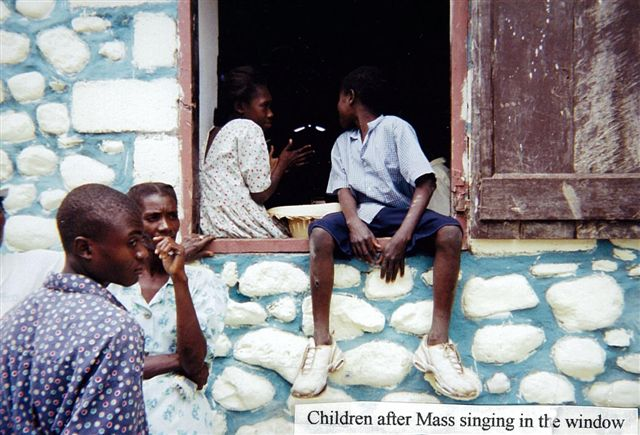 Children sitting in the window, singing after Mass.