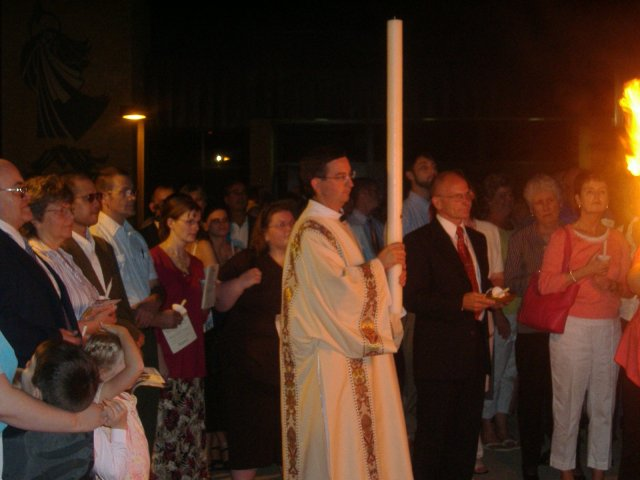 "Deacon Mike carries the Paschal Candle and proclaims, ""Christ Our Light"" We proclaim: ""Thanks Be To God"""