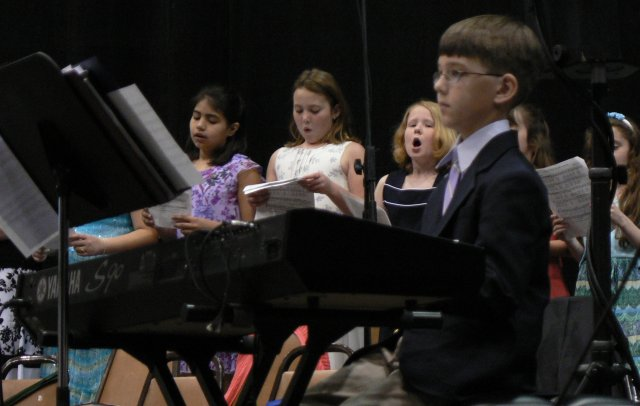 Ryan accompany's the children's choir. Look out Dan, here comes your replacement!