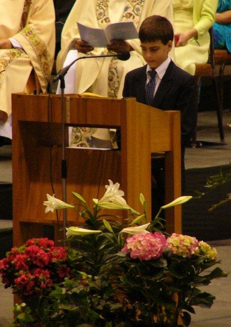 John proclaims the Word of God to the faithful.