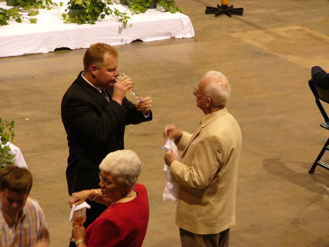Bob administers the Blood of Christ.